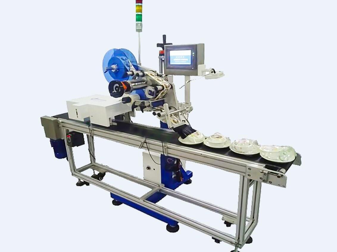 How to realize the automatic labeling process in food industry,like tableware?